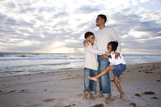 father with children on beach